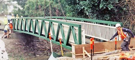Trussed metal bridges from outdoor structures australia for Metal garden bridge designs